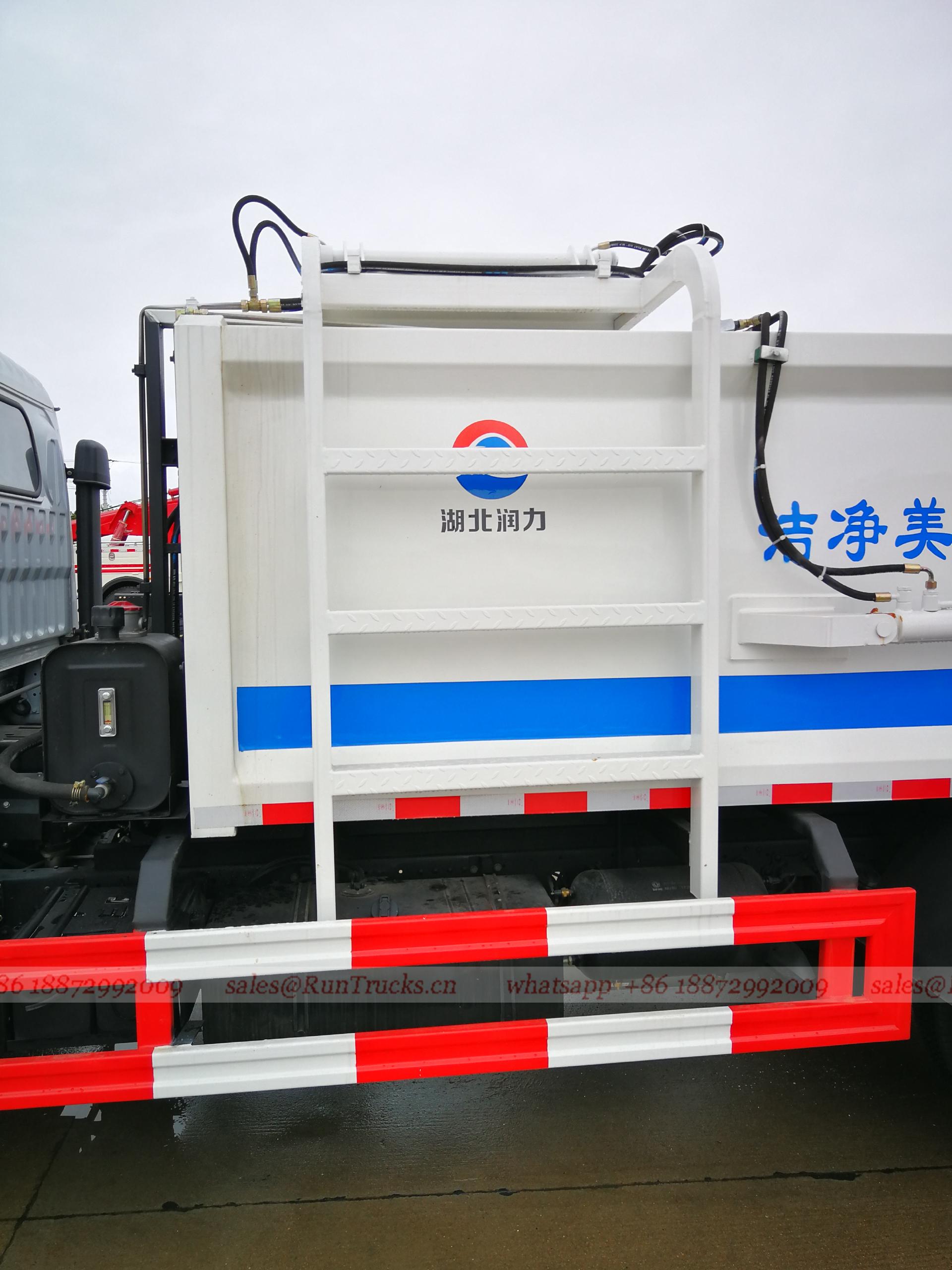 China Dongfeng 5 cbm lateral de carga hidráulica cubo colgan