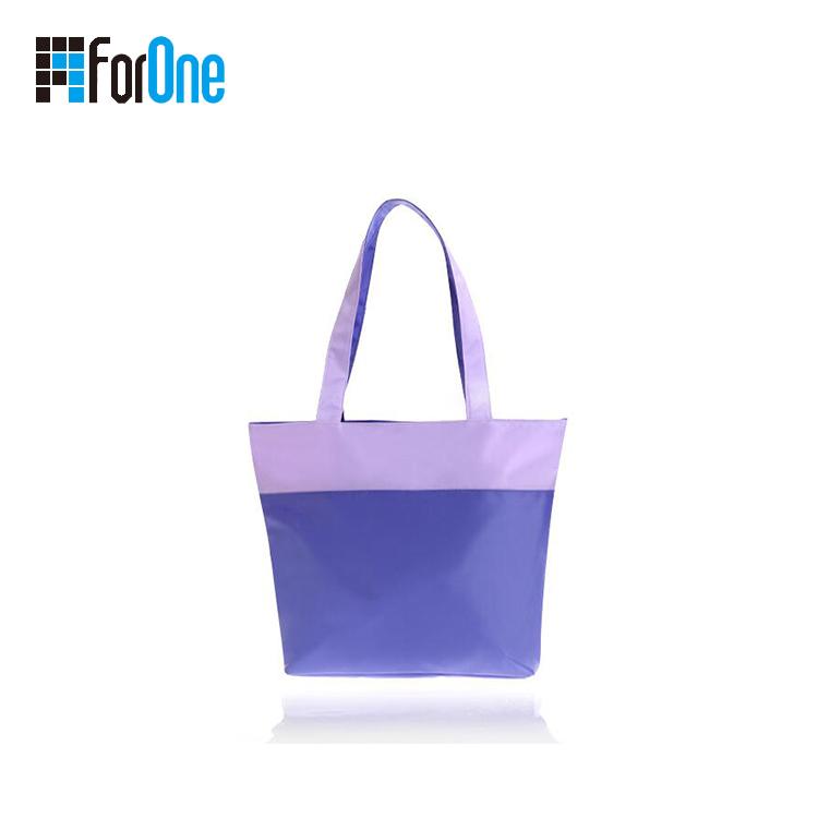 光胶PVC沙岸包手提包