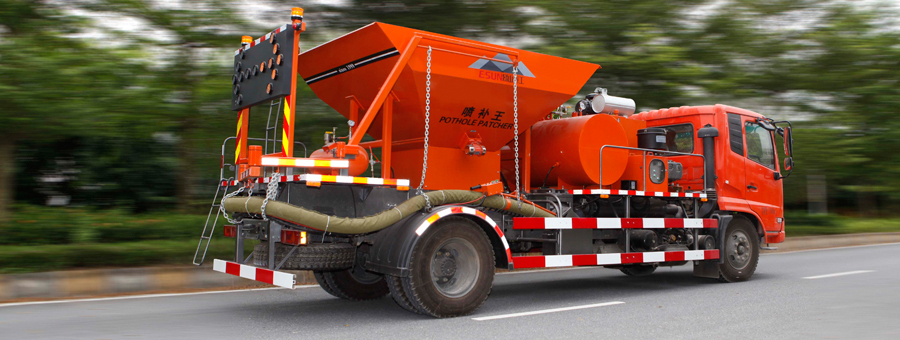 ESUN asphalt pothole repair by spewing truck