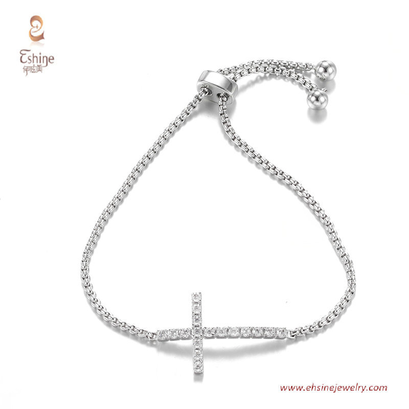 BR3423- cross center bracelet with round clear cz & Rhodium