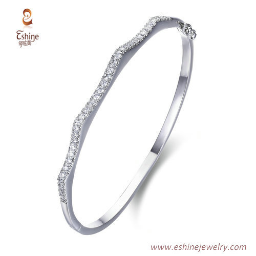BA1101- wave style bangle with clear CZ micropaved & white r