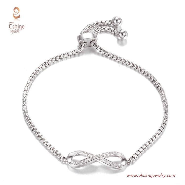 BR3424- Infinit logo bracelet with round clear cz & Rhodium