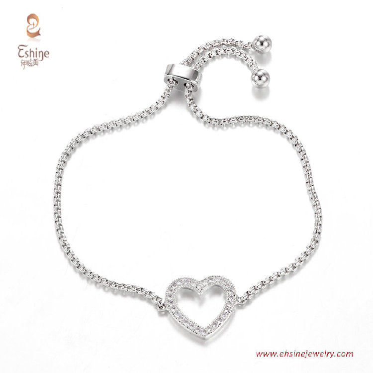 BR3431- love heart center bracelet with round clear cz & Rho