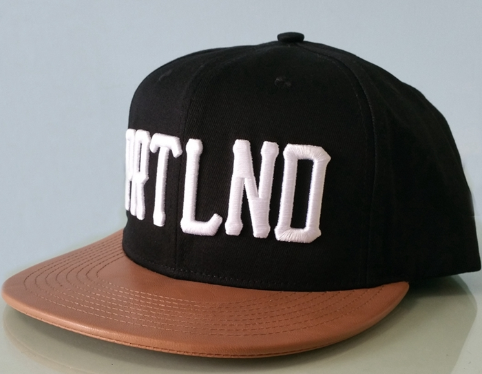 Custom leather brim snapback cap hat company in China