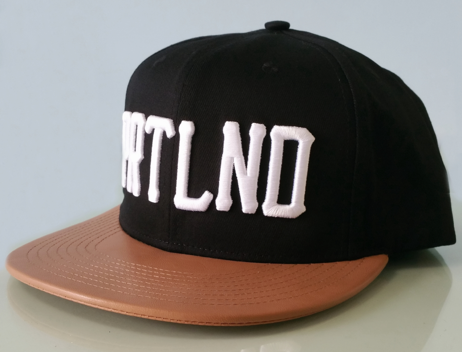 Brown leather brim snapback cap with white 3D embroidery cap