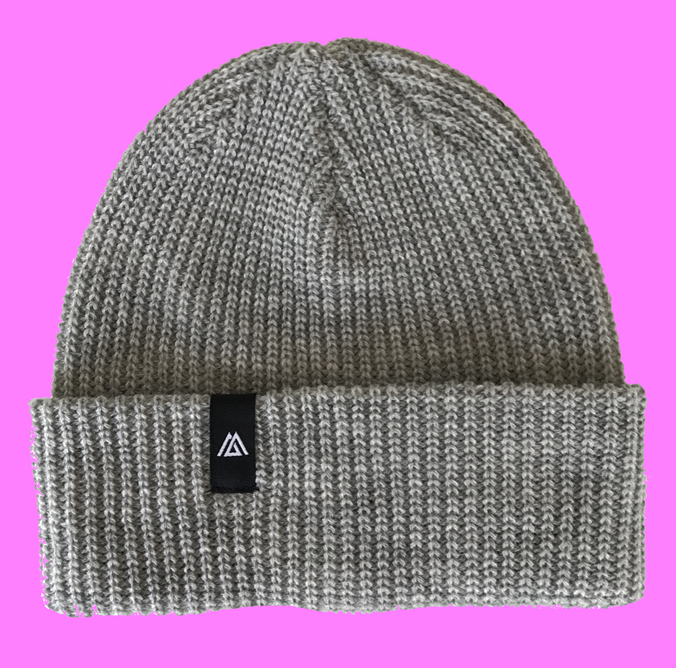 Warm winter beanie hat with woven label supplier